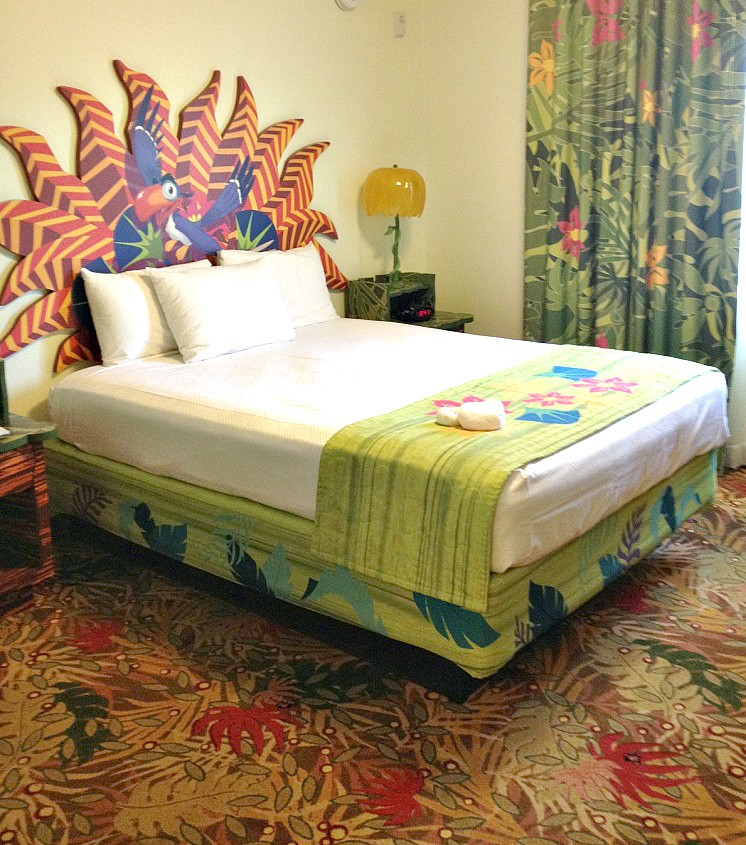 Bed with Zazoo headboard in the Lion King Family Suite at Art of Animation Resort