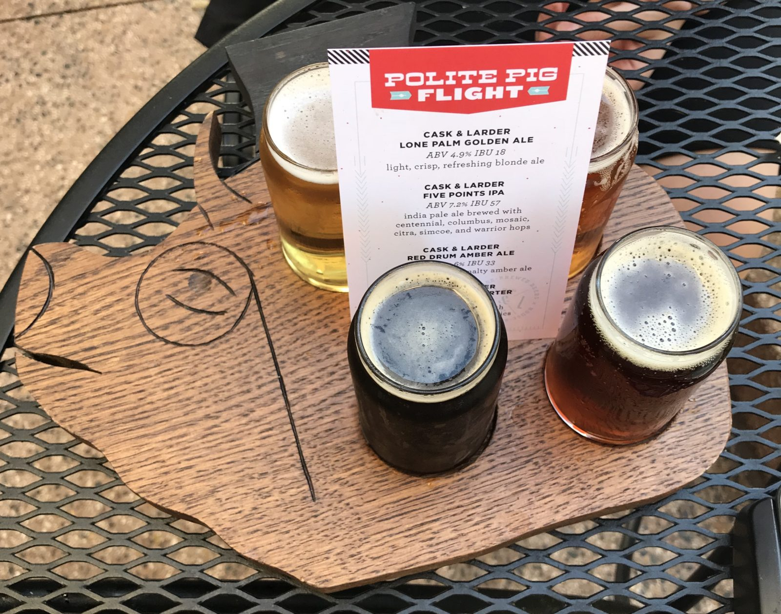 Beer Flight served on a wood platter in the shape of a pig head