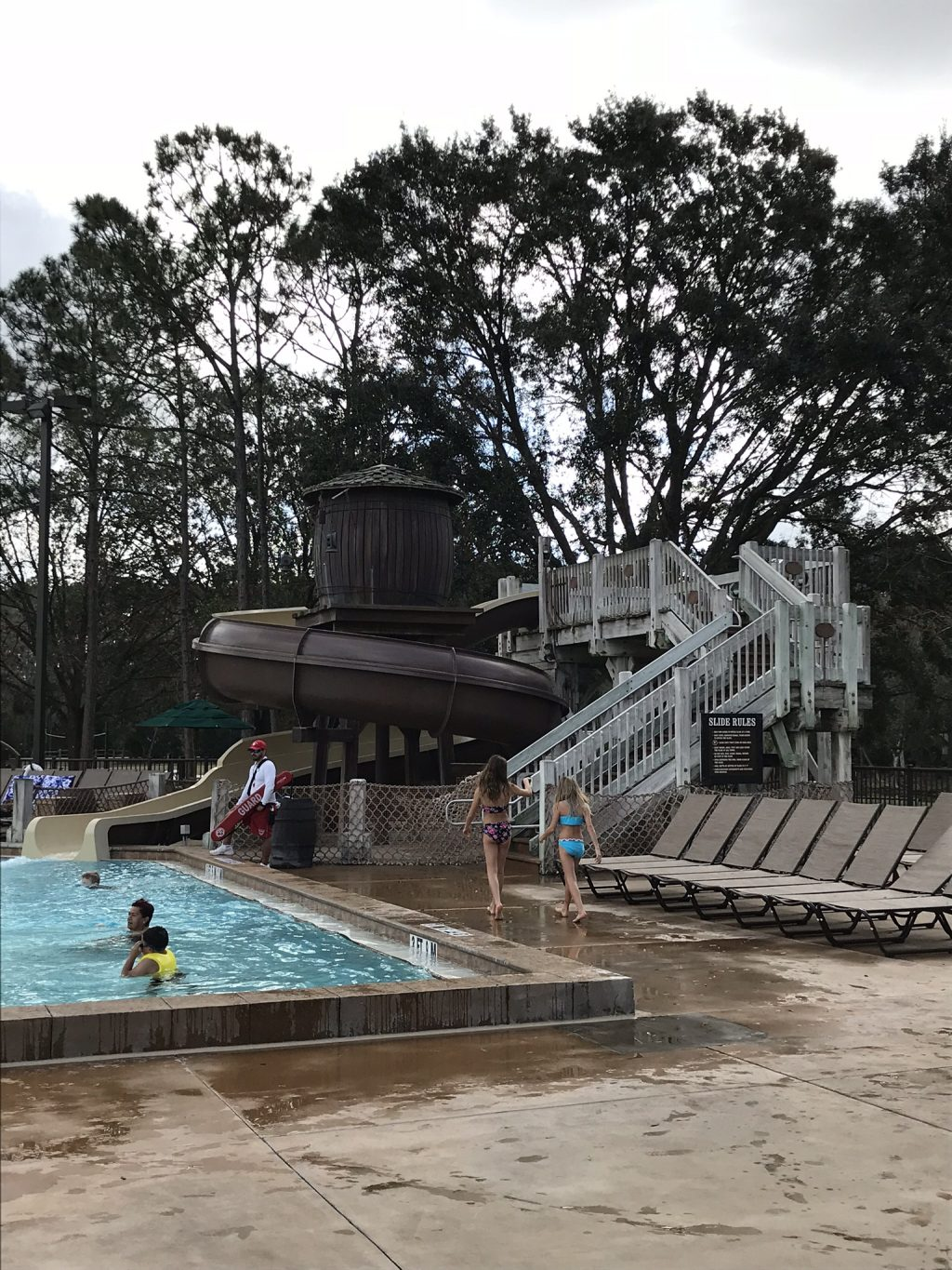 people enjoying the pool and large water slide at Fort Wilderness Campground