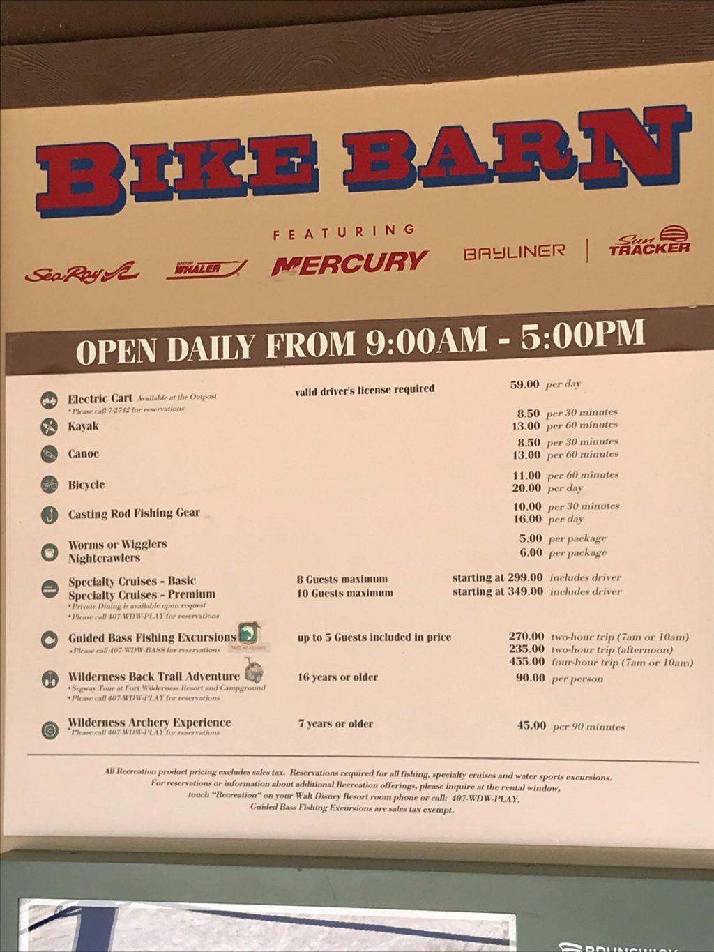 Bike Barn sign with activities and hours