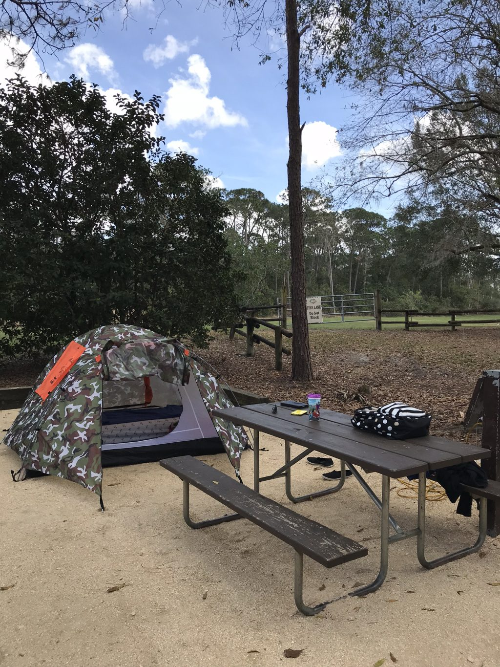 camping at disney world tent campsite with picnic table