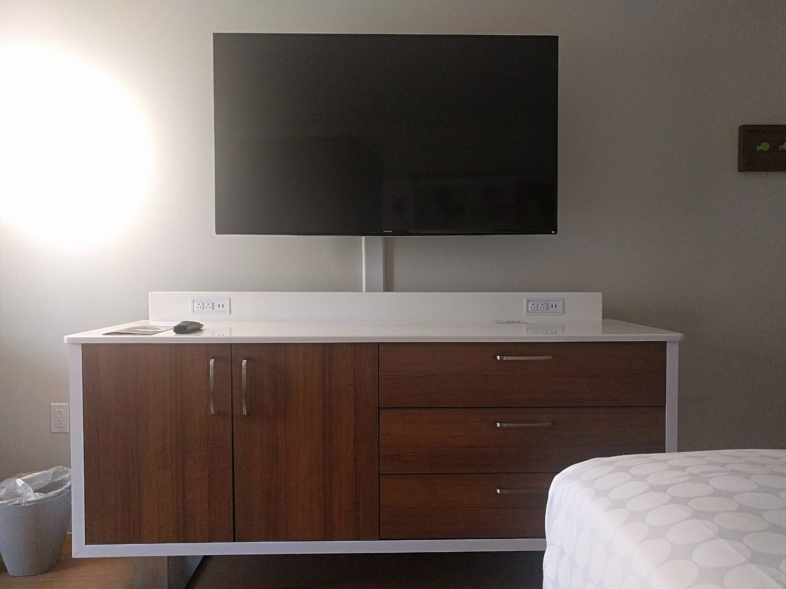 tv and dresser in the room