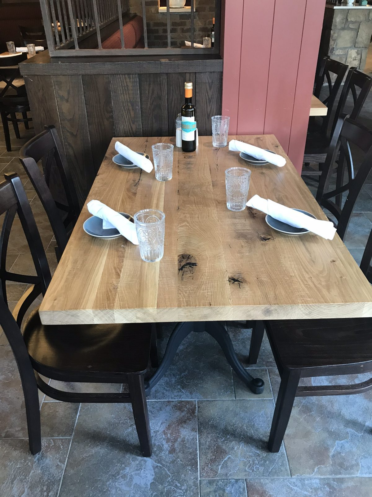 table set up with glasses, bread plates and silverware