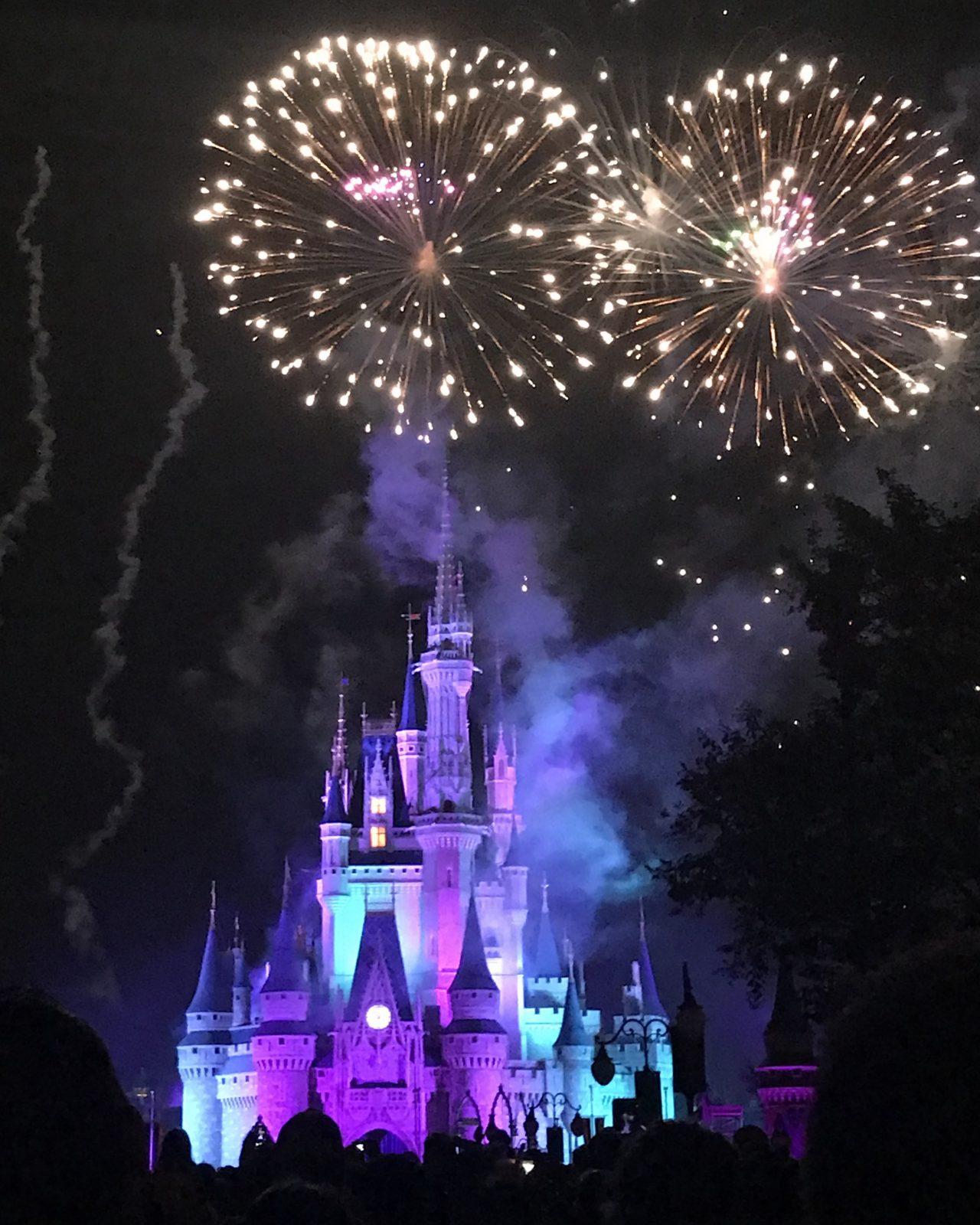 nighttime fireworks over Cinderella's castle