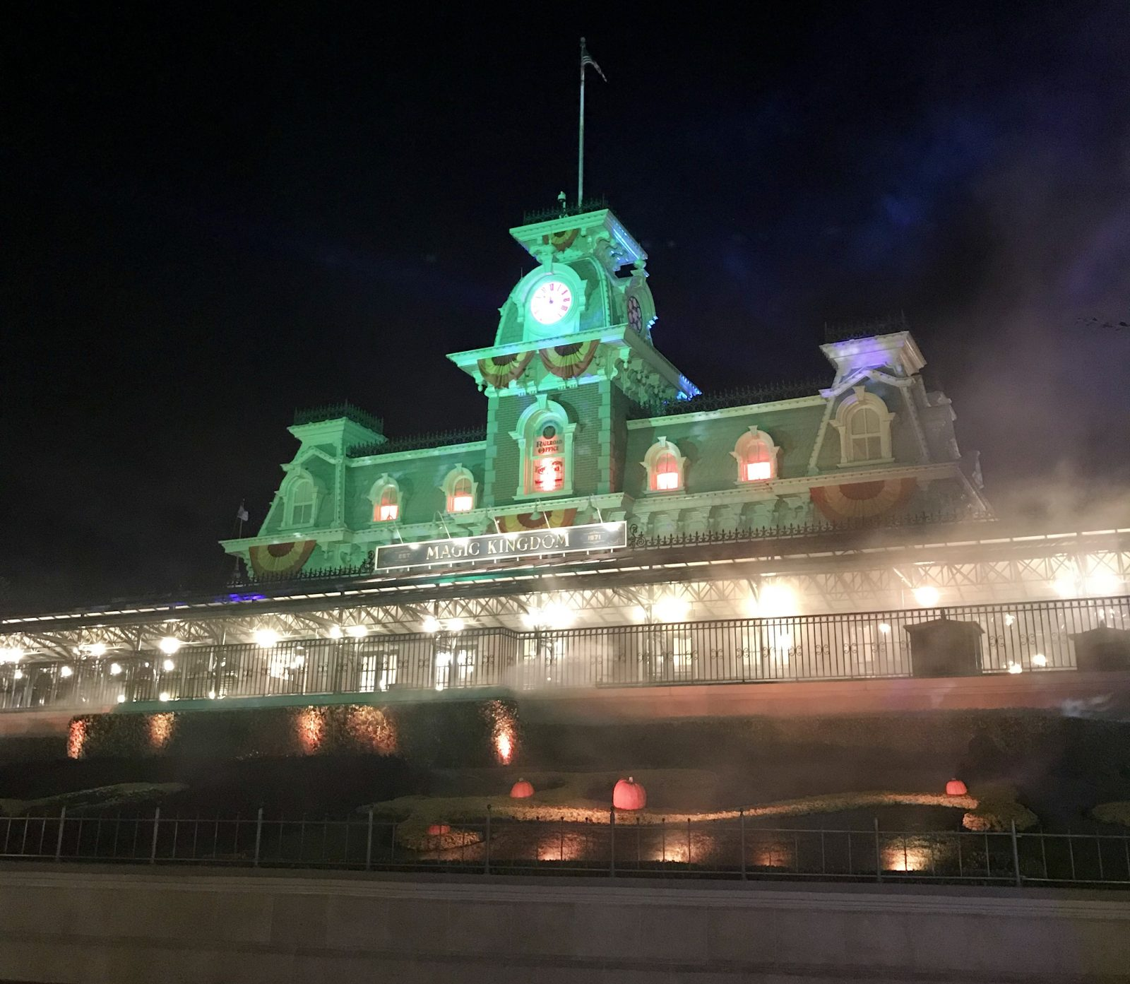 magic kingrom entrance at night decorated for halloween