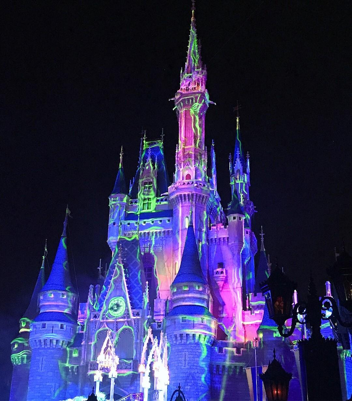 cinderella's castle at night during The Hocus Pocus Villian Spelltacular stage show