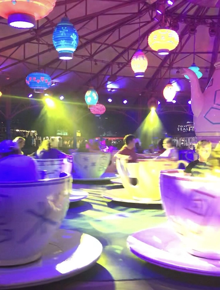 teacup ride at night with lantern lights