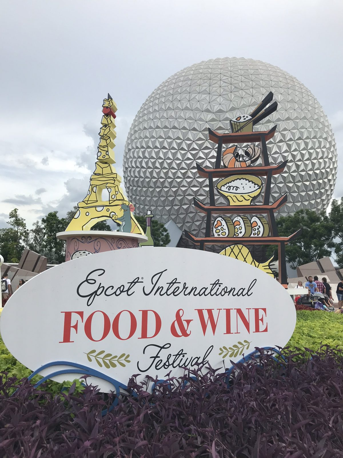 epcot food and wine festival decorations with spaceship earth geosphere in the background