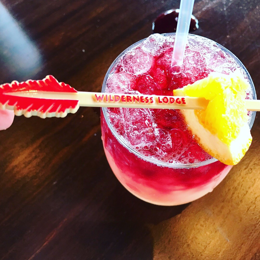 Cascadia Sangria Cocktail with wilderness lodge arrow skewer with lemon