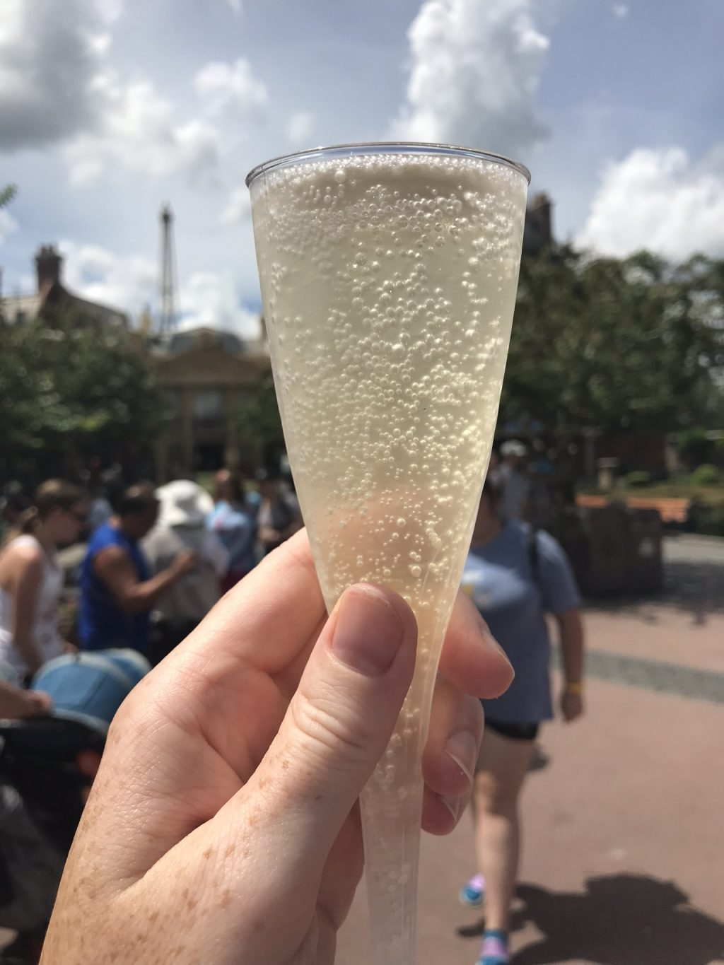 bubbly adult beverage with people in the background