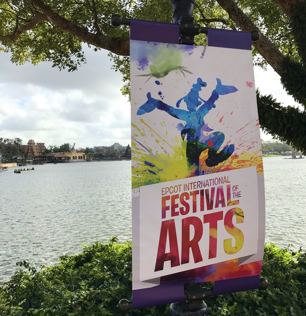 Epcot International Festival of the Arts sign with waterway in the background