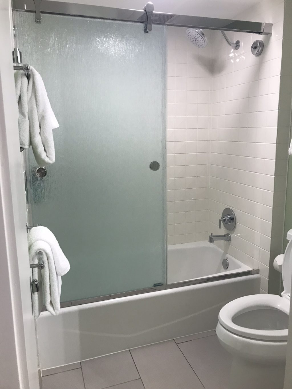 Shower tub and toilet area in an All Star Movies Resort refurbished room