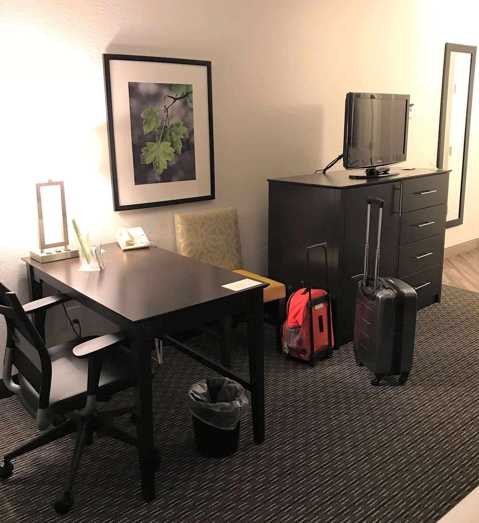 television and desk area in the hotel room