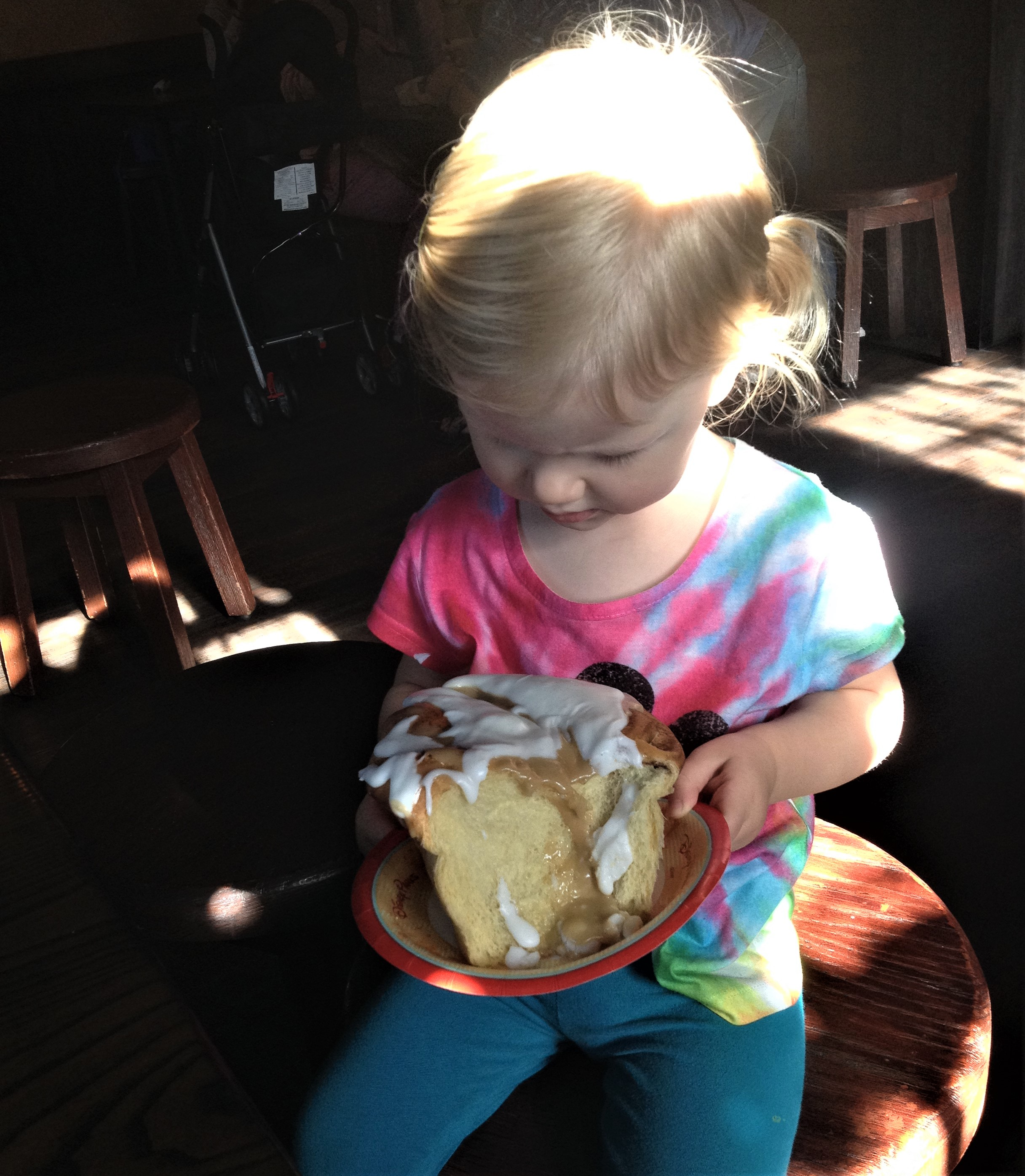 girl with cinnamon roll at gaston's tavern