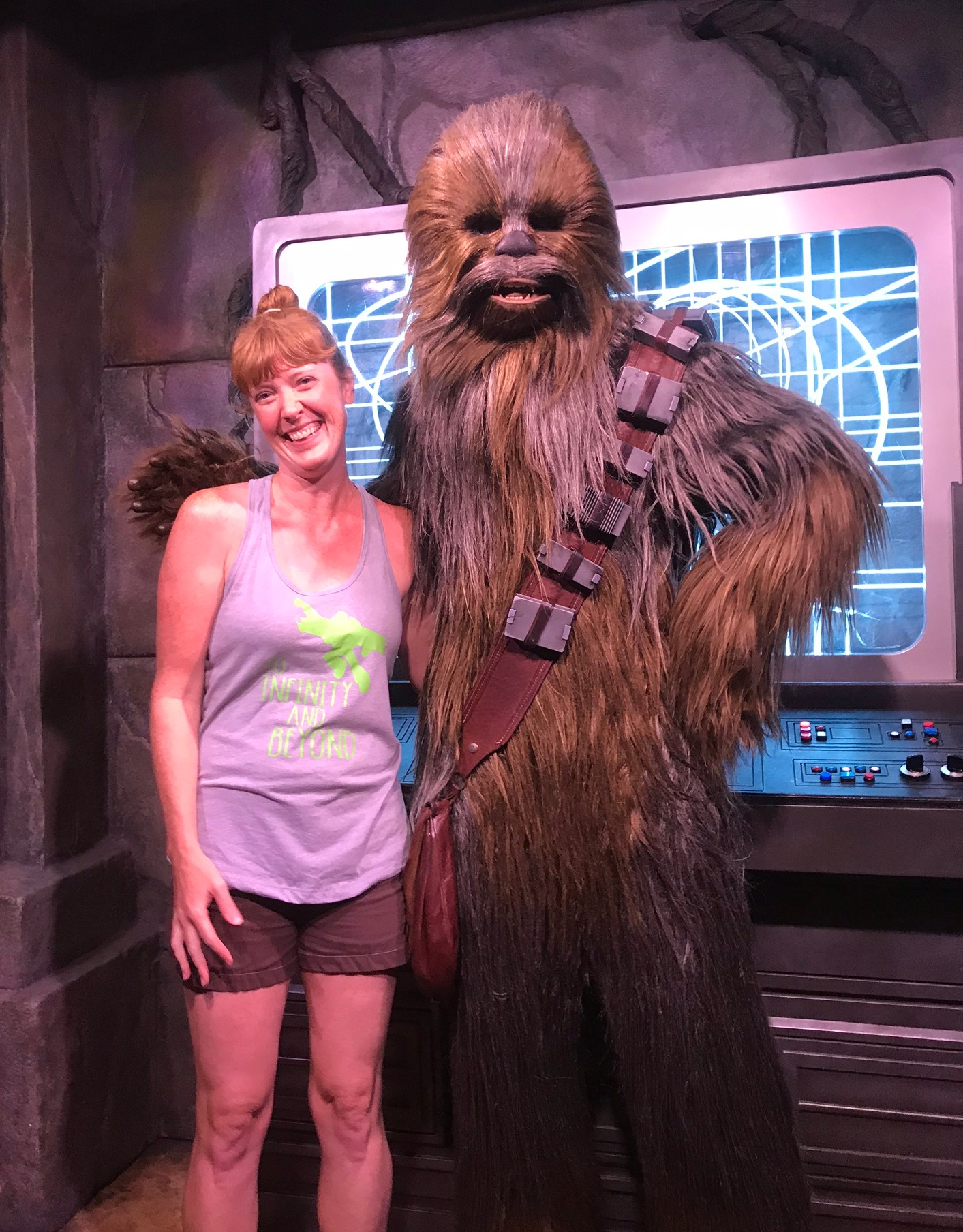 woman posing with disney character chewbaca