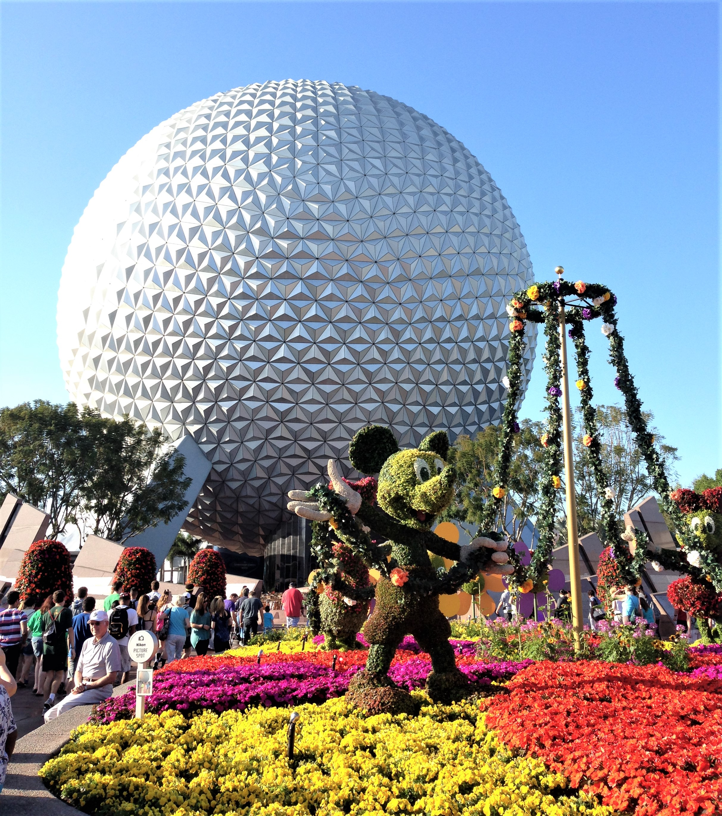 spaceship earth with flowers - disney world weather in march