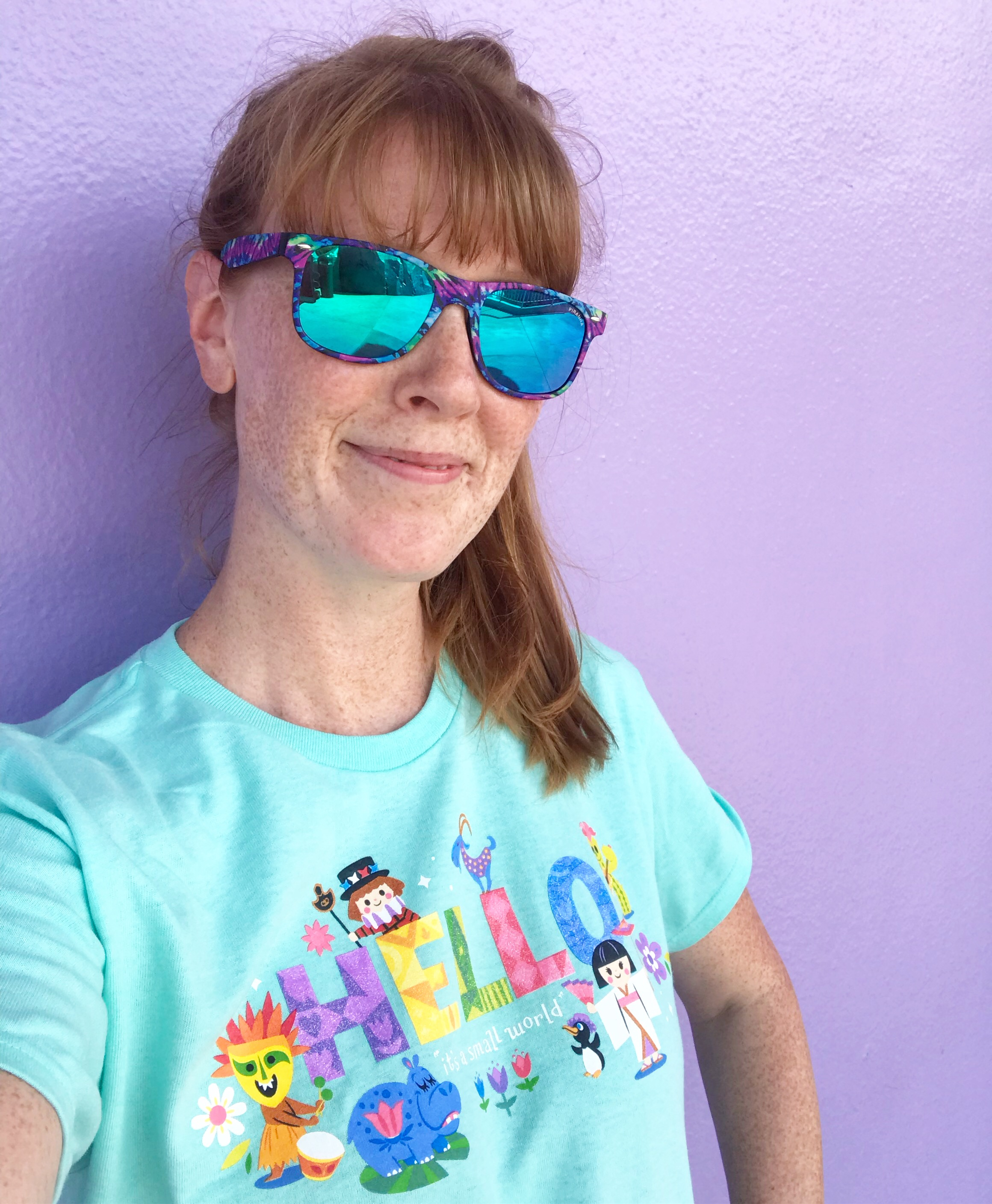 woman in disney t-shirt and sunglasses - disney world weather in august