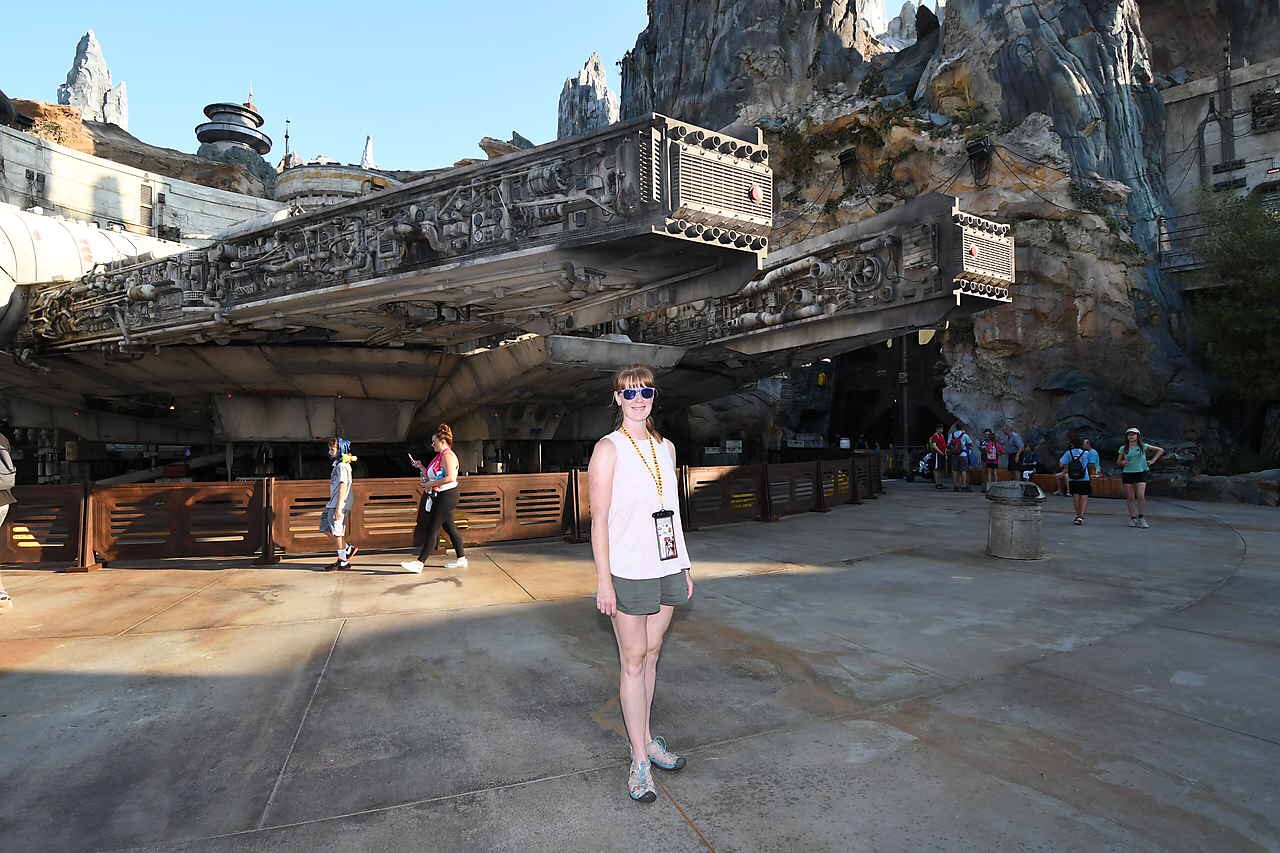 woman posing in front of galaxy's edge