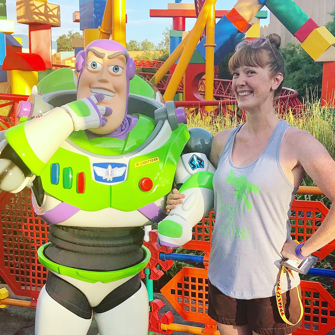 woman posing with disney character buzz lightyear