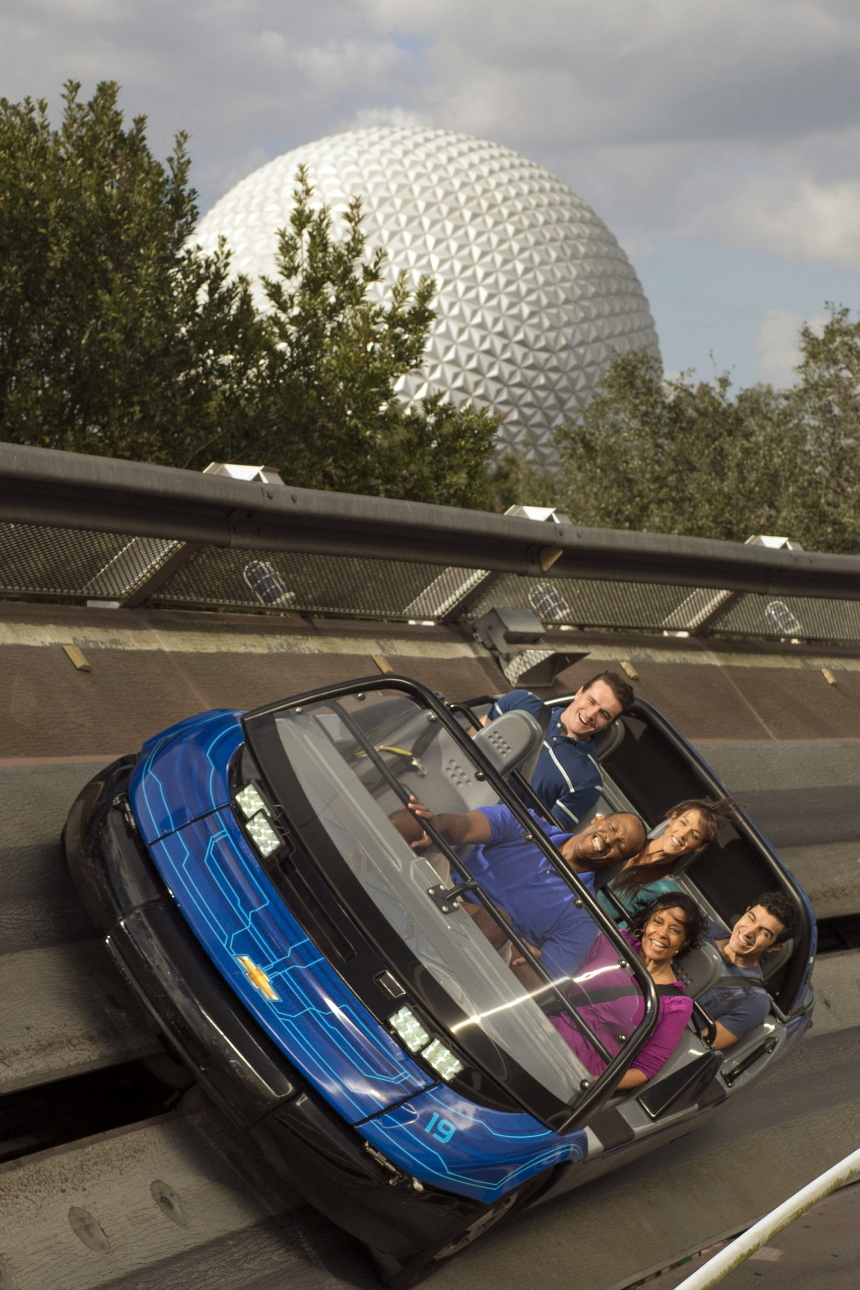 people riding test track in epcot