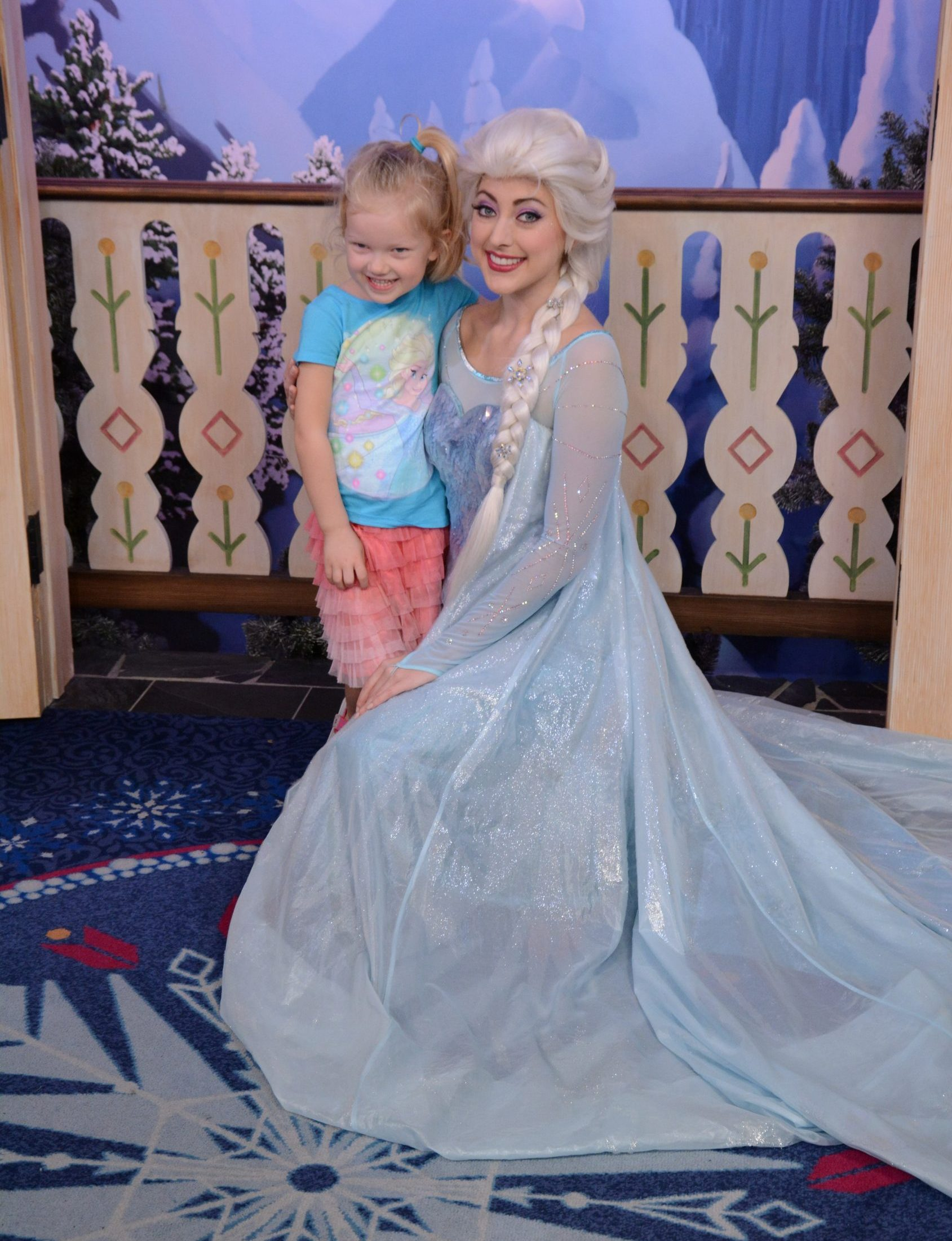 little girl meeting elsa in epcot