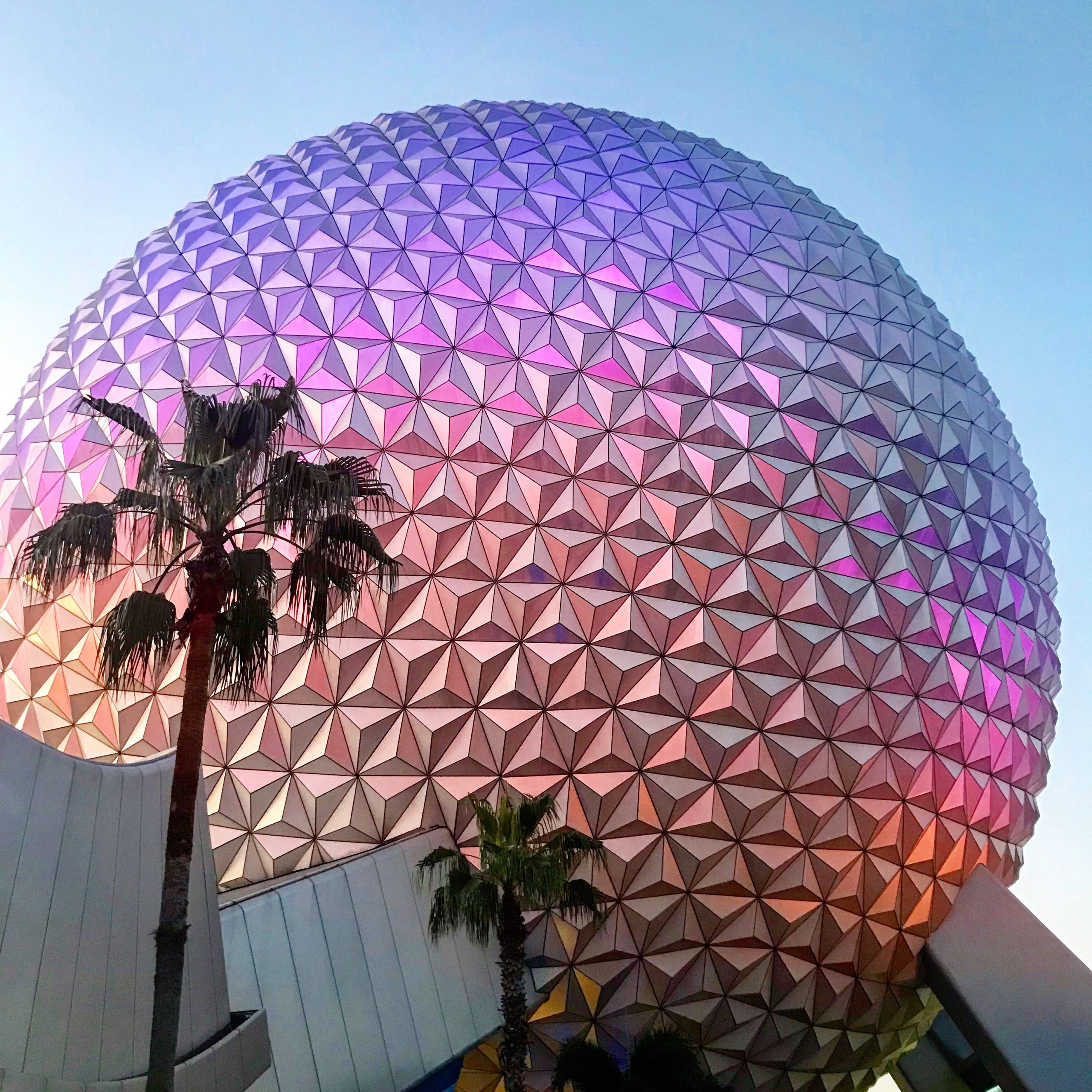 epcot's spaceship earth illuminated at dusk