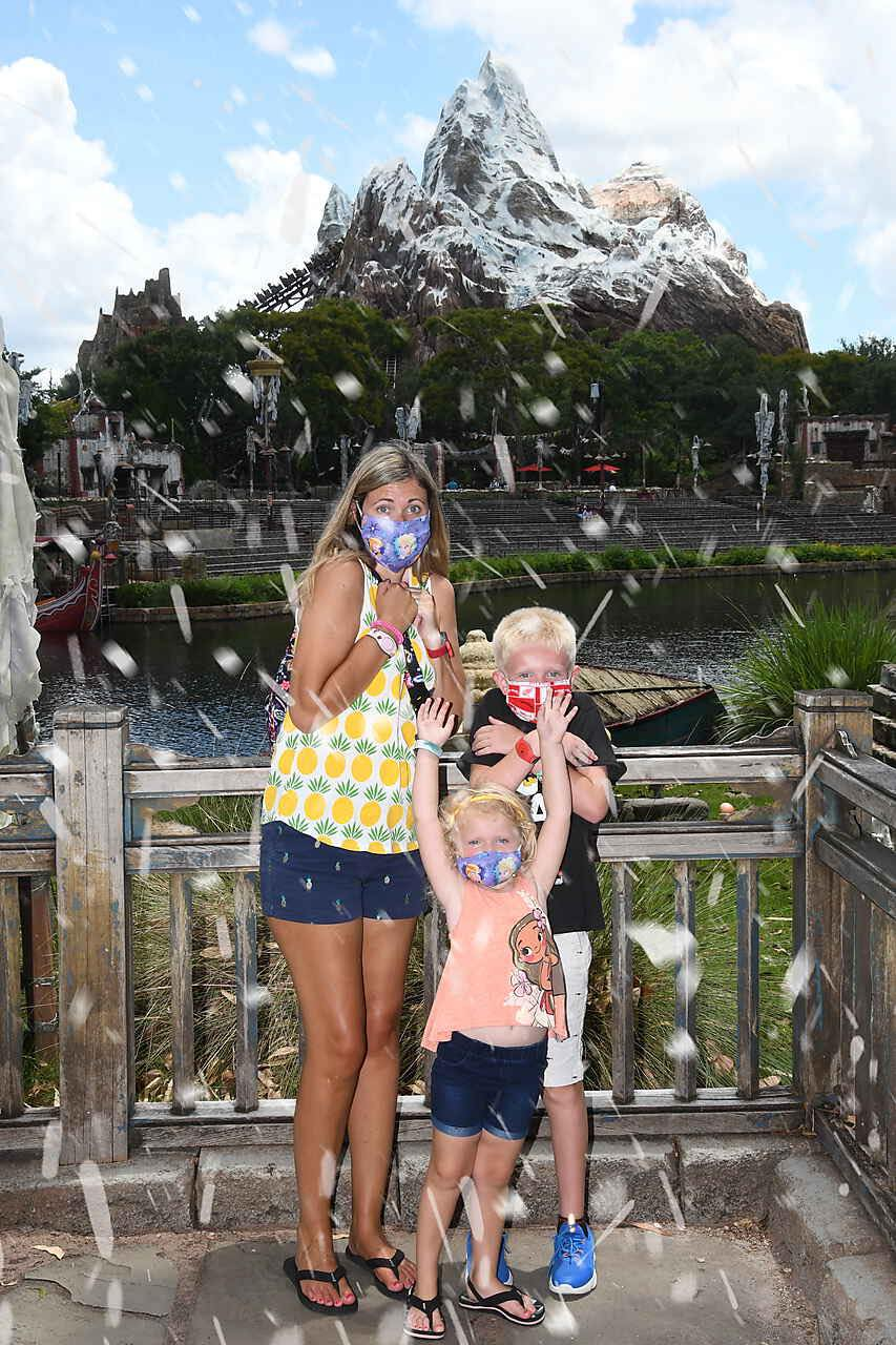family in front of expedition everest