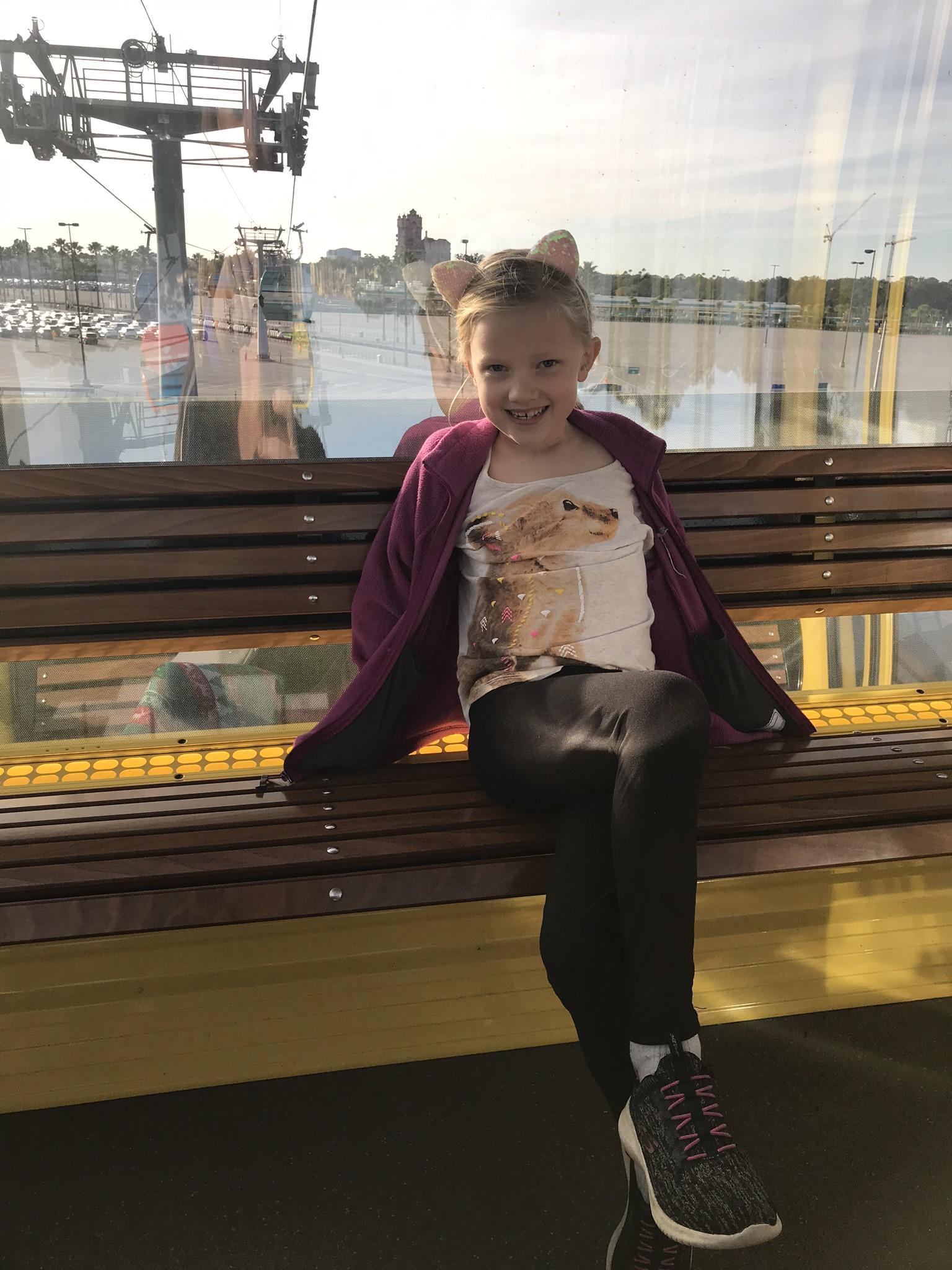 girl on skyliner at disney world